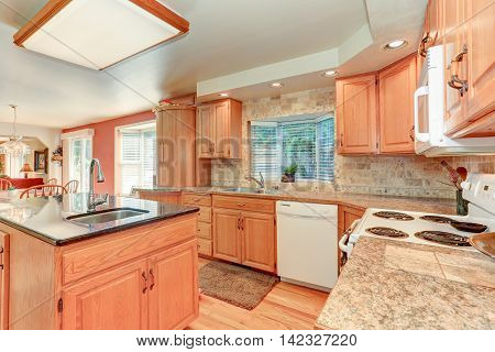 Bright Kitchen Interior With Oak Wood Cabinetry