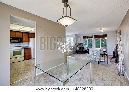 Elegant Bright Dining Area With Glass Table And Nice Decor
