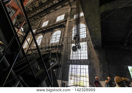 Calumet, Michigan,  USA - July 21, 2016: Tour of the interior the Quincy Copper Mine in the Keweenaw National Historic Park in Michigan's Upper Peninsula.