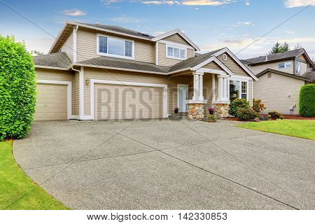 Neat Beige Home With Two Garage Spaces.
