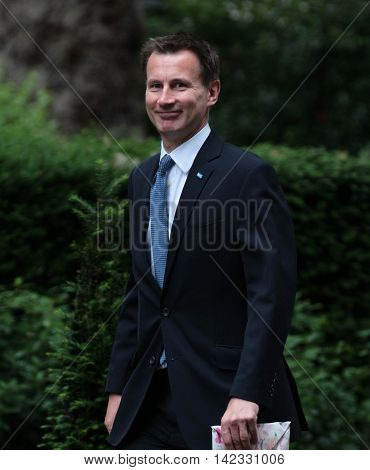 LONDON, UK, JUN 14, 2016: Jeremy Hunt carrying a wrapped present arriving in Downing Street for the weekly cabinet meeting