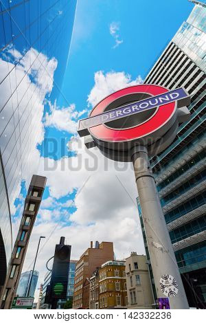 Underground Sign With Skyscrapers In London, Uk