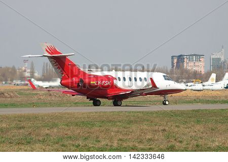 Kiev Ukraine - April 14 2012: Hawker 900XP Business Jet on the runway preparing for takeoff