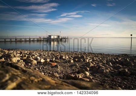 the shore of Lake Constance / Bodensee to the Alps in summer