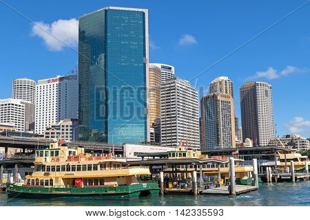 SYDNEY, AUSTRALIA - APRIL, 2016 : Sirius ferry docking in front of Circular Quay Railway station surrounded by tall hotel buildings in Sydney, Australia on April 20, 2016.