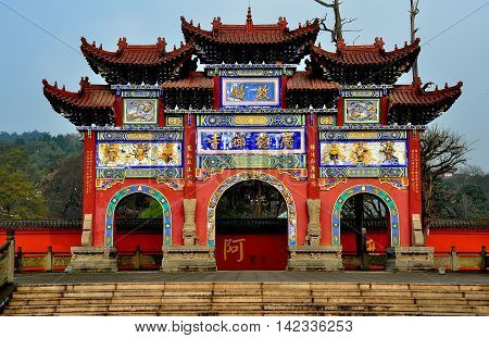 Sui Ning China - March 14 2015: Great ceremonial gate with three arches carved figures and flying eave roofs at the Guang De Si Buddhist Temple *