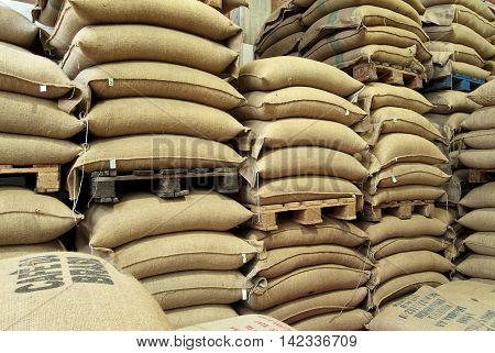 Milan - Italy, july 20 - 2016: Coffee Roasting Company, Stock burlap sacks full of coffee in warehouse