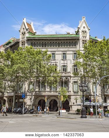 BARCELONA SPAIN - JULY 5 2016: Architecture along Passeig de Gracia street in Barcelona Spain
