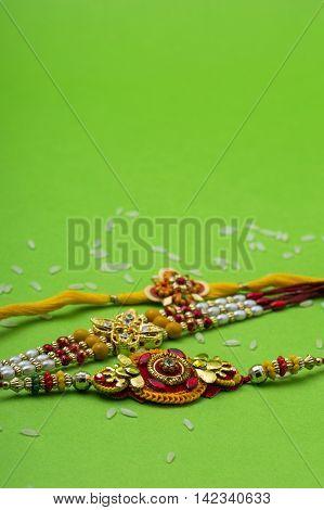 Indian festival: Raksha Bandhan background with Rakhi.