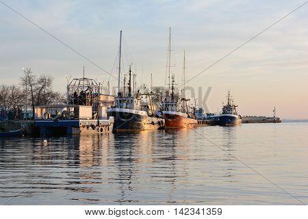 Fishing trawlers at sunset, Black Sea, Bulgaria