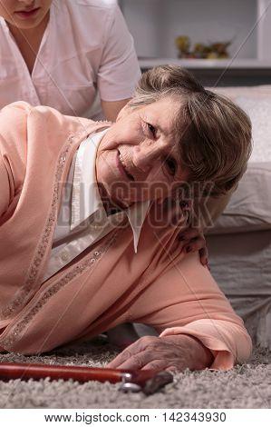 Elderly Woman Has Fallen Over On Floor