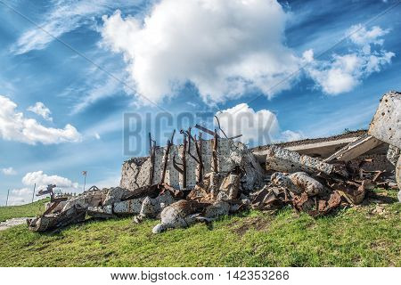 Monument to Soviet soldiers piled rubble destroyed after the hostilities of 2014. DNR Ukraine Saur-Tomb. poster
