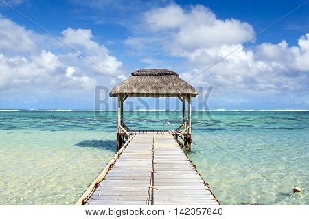Wooden pier in Bel Ombre beach, Mauritius island