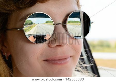 The Woman In Sunglasses Driving A Car