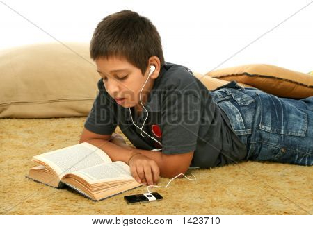 Boy Reading And Listening Music