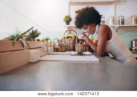 Proprietor Of A Juice Bar Calculating A Her Business Expenses