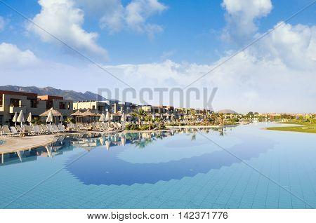 KOS ISLAND, GREECE - CIRCA AUGUST 2012: Pool area of luxury spa hotel Astir Odysseus Kos, Tigaki, Kos island, august 2012