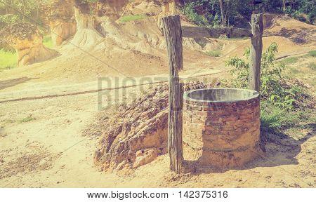 Water Well Oasis in Desert dryland in vintage tone