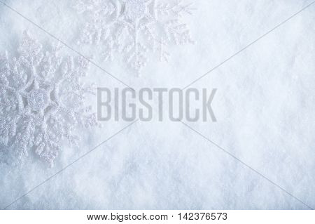 Two Beautiful Sparkling Vintage Snowflakes On A White Frost Snow