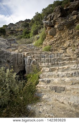 Stairs on the rock for way to Preveli beach, Crete, Greece