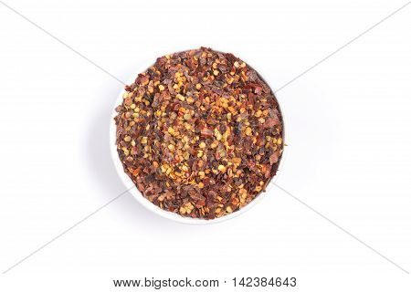 Calabrian pepper. Dry pepper into a bowl in white background