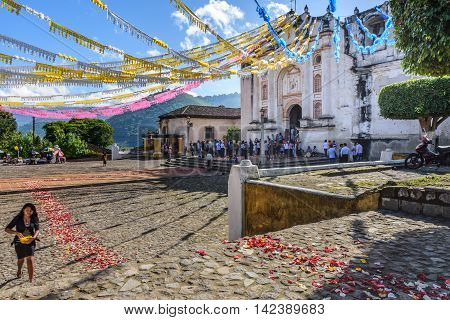 San Juan del Obispo Guatemala - June 26 2016: Villagers wait for procession to leave church as part of St John's Day celebrations in small village named after the patron saint. Near Antigua, a UNESCO World Heritage Site.