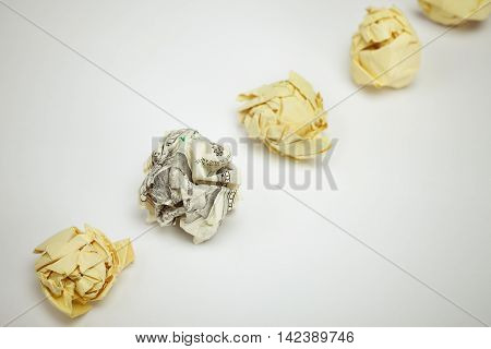 Crumpled dollar bill among office paper. Business concept.