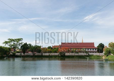 The Thai Temple Near Lake With Blue Sky