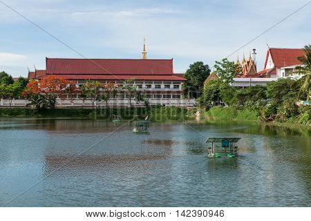 The Thai Temple Near Lake With Water Turbine By Solar Cell