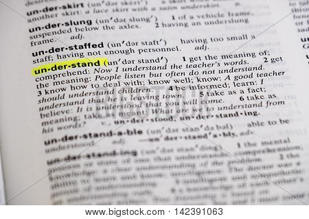 The word understand is highlighted and defined in a dictionary.