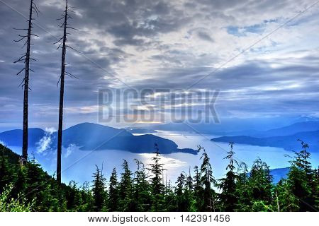 Sunbeams through clouds. Bowen Lookout in Cypress Mountain Provincial Park North Vancouver British Columbia Canada.