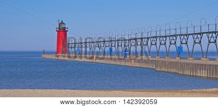 The South Pierhead Light in South Haven Michigan is at the entrance to the Black River from Lake Michigan. It was established in 1872 and is still operational. The catwalk links the lighthouse to the shore.