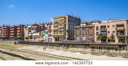 GIRONA SPAIN - JULY 6 2016: Modern architecture along the waterfront in Girona Catalonia Spain