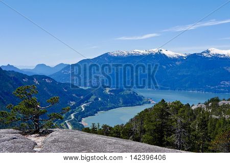 Road by ocean and mountains. Stawamus Chief Provincial Park near Squamish British Columbia Canada.