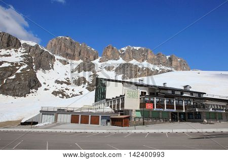 DOLOMITES, ITALY - APRIL 7, 2014: Passo Pordoi on April 7, 2014 in Dolomites, Italy. With an elevation above 2000m, this high alpine mountain road is a landmark scenic route on Dolomites Alps.