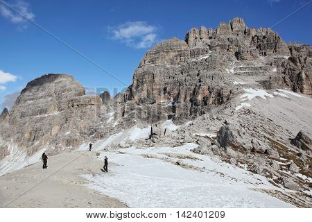 DOLOMITES, ITALY - NOV 2, 2014: Hiking trail to alpine hut Refugio Lavaredo on Nov 2, 2014 in Dolomites, Italy. It is unesco heritage and landmark stop for climbing the peaks of the Alps.
