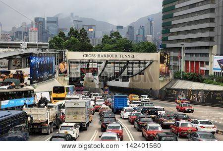 HONG KONG - JUNE 9, 2016: Traffic congestion at Cross Harbour Tunnel on June 9, 2016 in Hong Kong. It is the key tunnel connecting Hong Kong island and Kowloon.