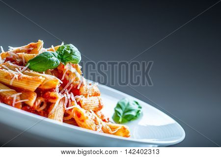Pasta Penne with Tomato Bolognese Sauce Parmesan Cheese and Basil. Mediterranean food.Italian cuisine.