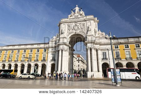 LISBON, PORTUGAL - September 25, 2015: The Rua Augusta Arch is a stone triumphal arch-like historical building and main attraction on the Praca do Comercio on September 25, 2015 in Lisbon, Portugal