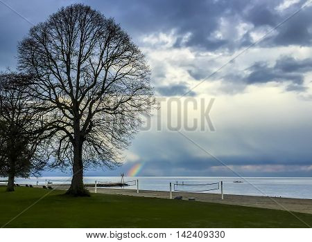 Beach area with rainbow beacon sculler and volley ball nets