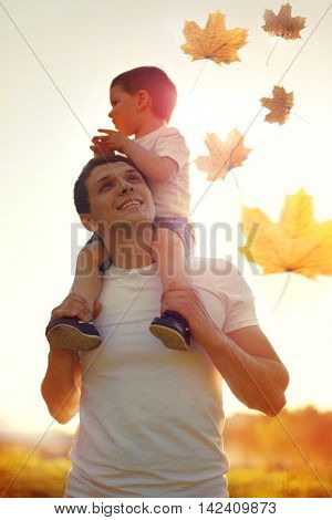 Happy Father And Son Child Walking Together Enjoying Sunny Autumn Park, Family Photo On Sunset, Flyi