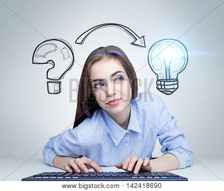 Woman at computer keyboard with question mark and light bulb sketch pictured at background. Concept of idea finding. Toned image