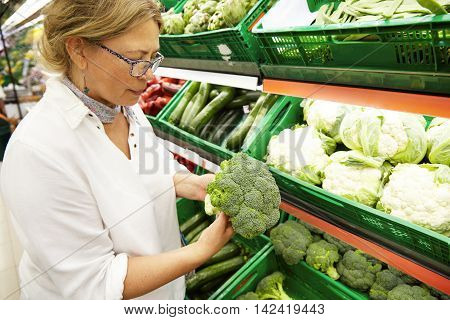 Close-up Profile Portrait Of Good-looking Middle-aged Caucasian Woman Vegetarian In Casual Clothes P