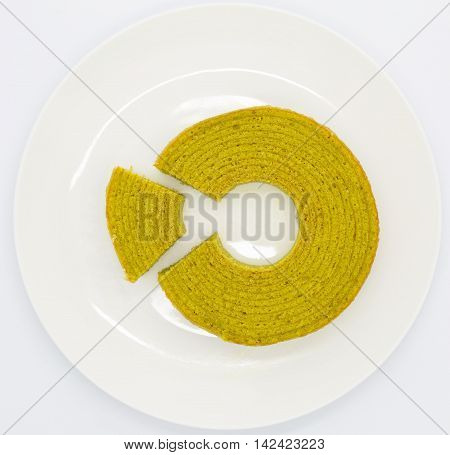 Green tea round layer cake on white plate