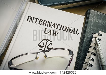International law book. Justice and legislation concept.