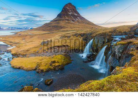 Kirkjufell Volcano Mountain with waterfalls, Iceland winter landscape