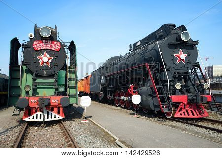 ST. PETERSBURG, RUSSIA - MARCH 30, 2016: Soviet steam locomotives P-36 and LP-18 on the October railway. Historical landmark of the city Saint Petersburg