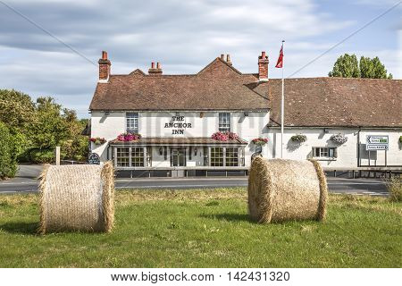 August 2016, Sidlesham, West Sussex UK, Two Bales Of Hay Outside Of The Anchor Inn Sidlesham West Sussex,