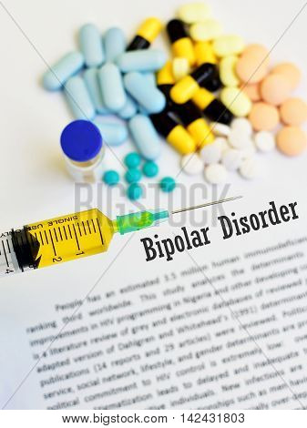 Syringe with drugs for bipolar disorder treatment, medical concept