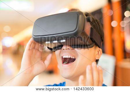 man wear virtual reality headset happily asian